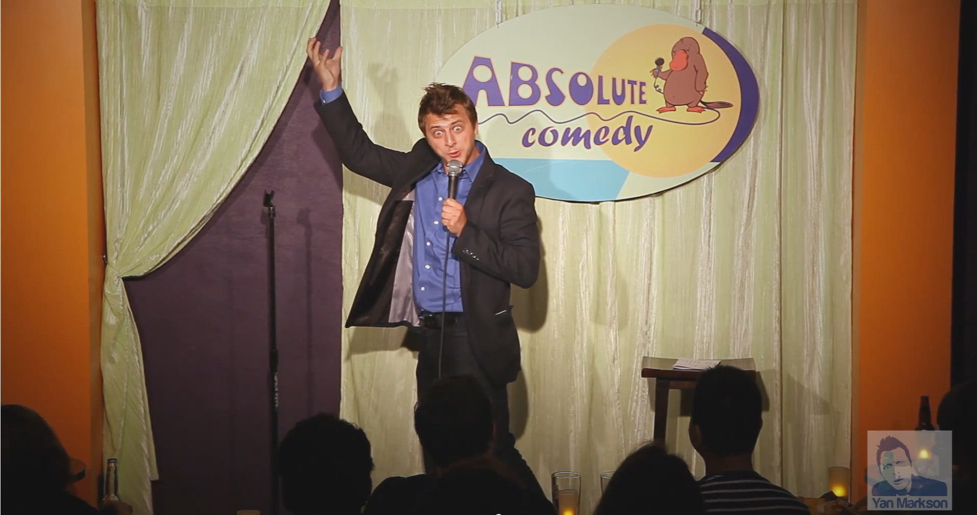 Yan Markson doing standup and magic at Absolute Comedy